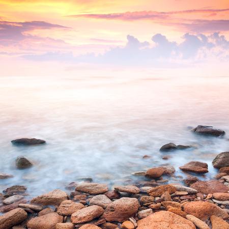 beautiful sunrise over the rocky sea coast, wonderful world photo