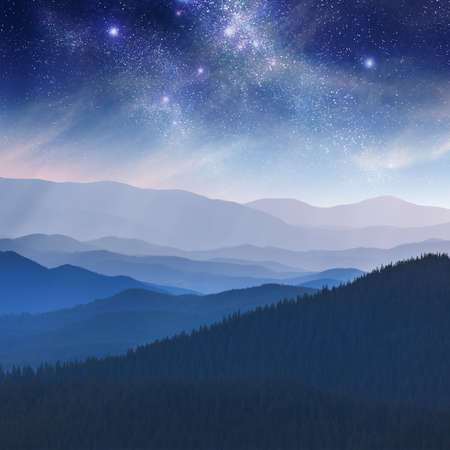 Night landscape in the mountain with stars - dark blue sky photo