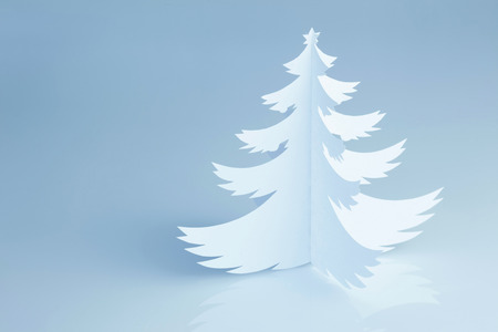 Handmade paper cut Christmas tree on cold white background - horizontal photo