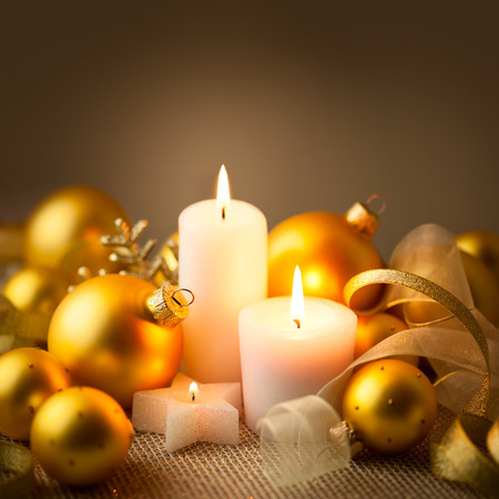 Christmas Golden Candles Background with Baubles and Ribbons Stock Photo