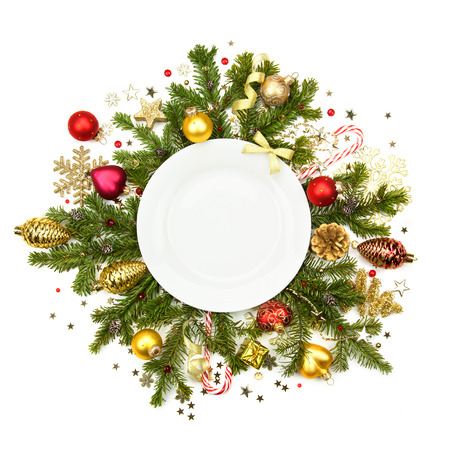 Christmas plate with fir, baubles, ribbons, stars and glitter -  isolated on white background photo