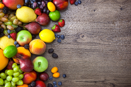 Colorful Fruits on wooden Table with water drops   photo