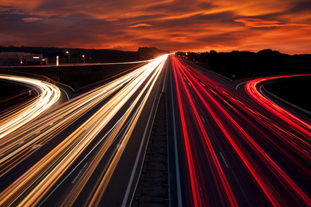 fast: Speed Traffic - light trails on motorway highway at night,  long exposure abstract urban background Stock Photo