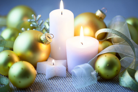 Night Christmas  Decorations with candles, baubles and ribbons - horizontal photo