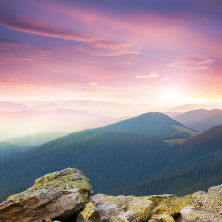 wilderness area: Red majestic Sunrise over the mountains  with big stones, Carpathians, Europe Stock Photo