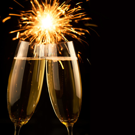 Beautiful golden champagne with sparklers on black background - square photo