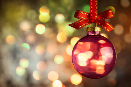 feliz navidad: Christmas  bauble over Beautiful magic bokeh background -  horizontal Stock Photo
