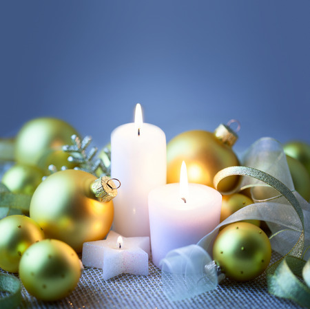 Blue Night Christmas background with candles, baubles and ribbons - copy space photo