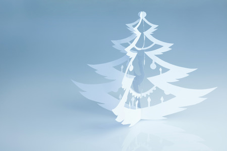 feliz navidad: Beautiful handmade paper christmas tree silhouette on light-blue  background