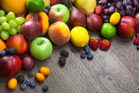 Mixed fresh Fruits on the  wooden background  with water drops and copy space photo