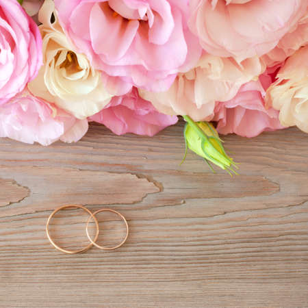 Gentle Vintage Wedding  Background with gold Rings and beautiful flowers photo