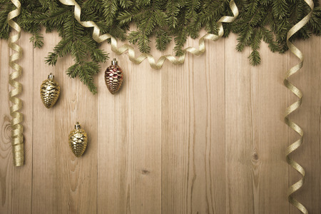 Christmas Vintage Background with fir tree, golden ribbon and decorations like pine cones photo