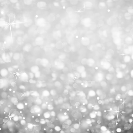 Silver Glittering Abstract Background - magic light and Stars Sparkles Stock Photo