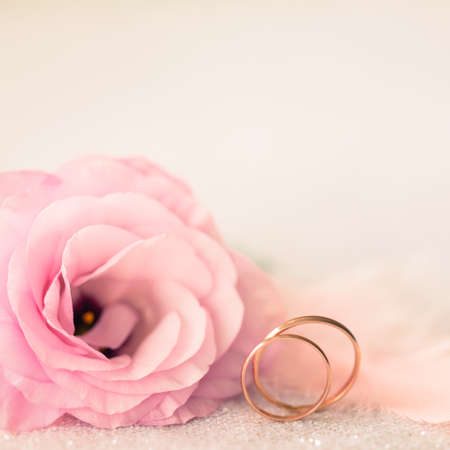Vintage Sile Wedding Background with Gold Rings and Beautiful Flower photo
