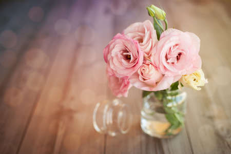 colorful still life: Colorful still life with roses in glass vase with bokeh background Stock Photo