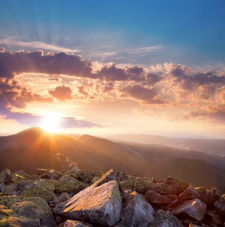 Beautiful  sunset in the mountains landscape. Dramatic sky and colorful stones. Carpathians, Ukraine, Europe photo