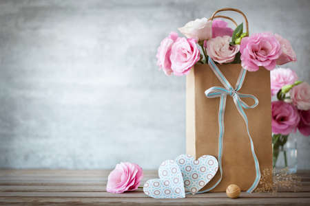 wood craft: Valentines Day background with pink roses, bow and paper Hearts Stock Photo