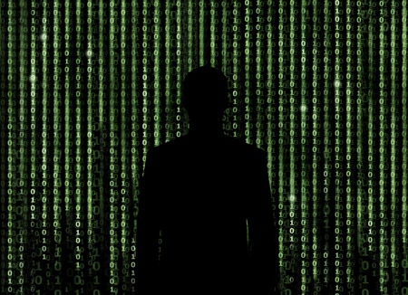 binary matrix: Silhouette of man looking through the digital matrix background