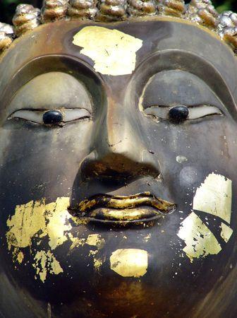 revere: Goldleaf of a Thai Buddha statue Stock Photo