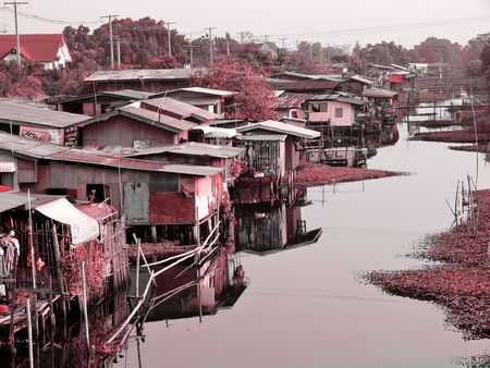 slum: Canalside slum in Bangkok