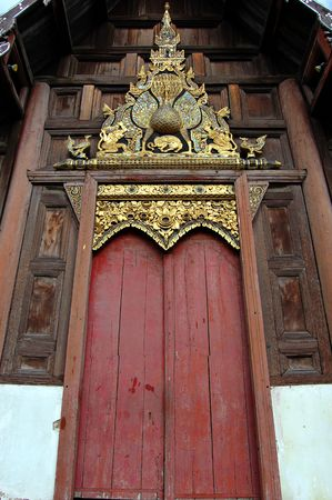 sturdy: Wooden door on a temple in Chiang Mai, Thailand