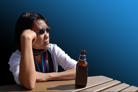 apathetic: Thai woman drinking beer with clipping path