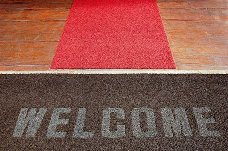 Welcome sign on a hotel entrance path photo