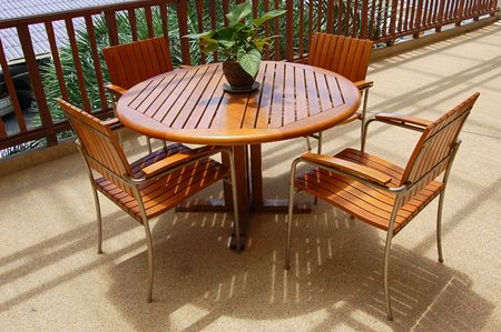 Wooden table and chairs on a veranda photo
