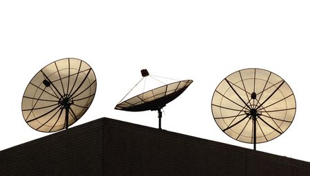 Three satellite dishes on a hotel roof with clipping path photo