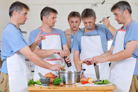 Composite of five cloned men trying to cook together but too many cooks have spoiled the broth Stock Photo