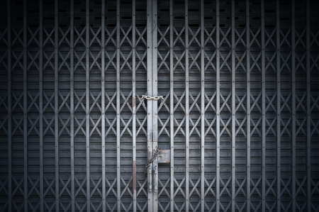 security shutters: Closed security grill and shutters over a shopfront Stock Photo