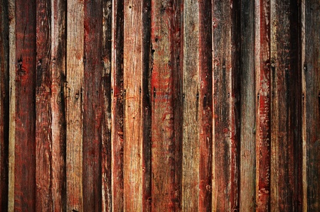 Background of a wooden wall smeared with red
