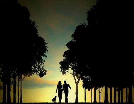 morning walk: Editable illustration of a couple walking through a wood at dawn or dusk with sky made using a gradient mesh