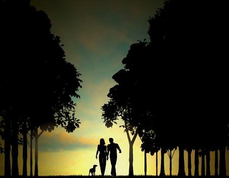 silhouettes lovers: Ilustración editable de una pareja paseando por una madera al amanecer o al atardecer con cielo utilizando una malla de degradado Vectores