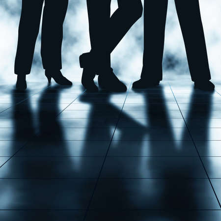 backlit: Editable vector illustration of the legs and reflections of three businesspeople made using a gradient mesh