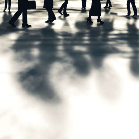 busy street: Editable vector illustration of people and their shadows walking along a street made using a gradient mesh