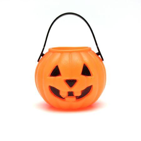 Orange Plastic Jack-O-Lantern on White Background Stock Photo