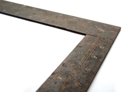 Old Metal L Square Ruler On White Background
