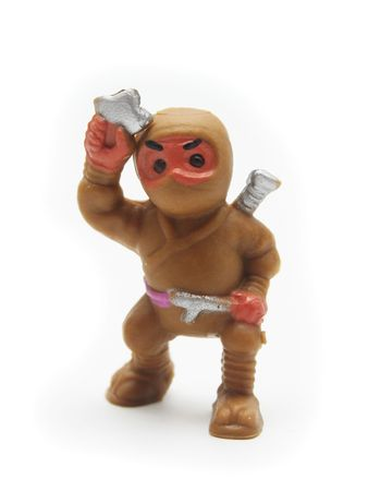 Isolated Brown Plastic Ninja on White Background