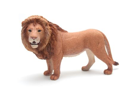 Brown Plastic Toy Lion on White Background Stock Photo