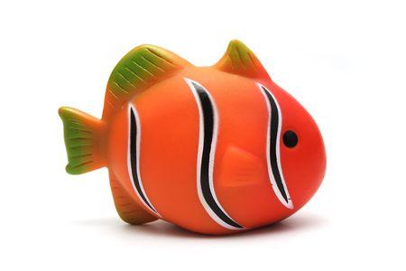 clown fish: Orange Plastic Toy Clown Fish on White Background