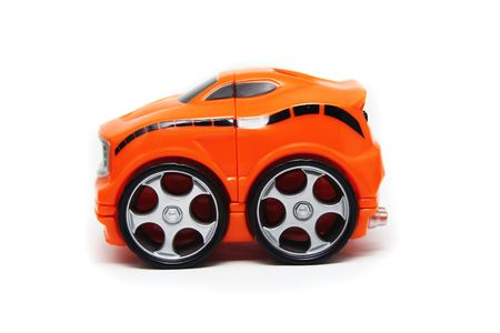 Side View of Orange Plastic Toy Race Car