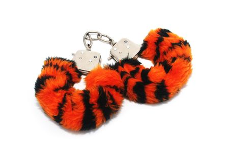 Tiger Stripe Furry Handcuffs on White Background Stock Photo - 5994355