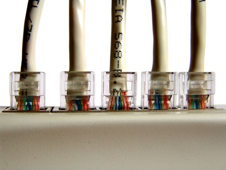 5 twisted-pair cables connected to a network hub, isolated photo
