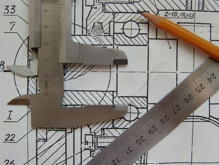 Engineer tools on a drawing photo