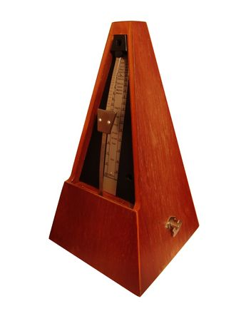 A brown metronome used for keeping cadences photo