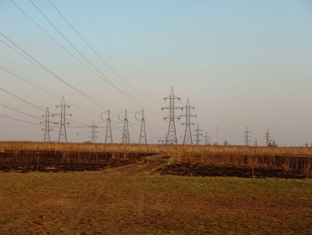 transmitting: A large power transmitting line on a field