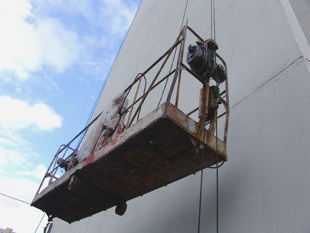 hydraulic lift: An industrial elevator on a building wall