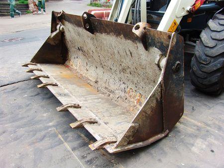 roadworks: A roadworks bulldozer dipper Stock Photo