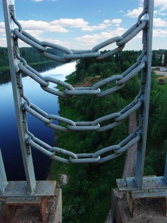 unreachable: A wild landscape behind chains